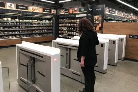 At the new Amazon Go convenience store in Seattle, customers scan their phone to enter. Jason Del Rey